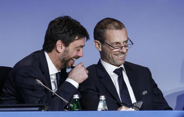Andrea Agnelli, presidente de la Juve, y Alex Ceferini, de la Uefa.