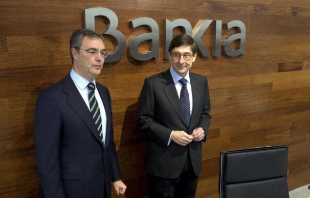 Fotografía de José Sevilla y José Ignacio Goirigolzarri