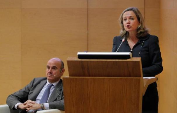 Luis de Guindos con la actual ministra de Economía, Nadia Calviño