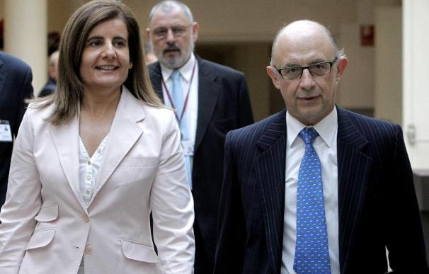 Los ministros de Empleo y Seguridad Social, Fátima Báñez, y Hacienda y Administraciones Públicas, Cristóbal Montoro.