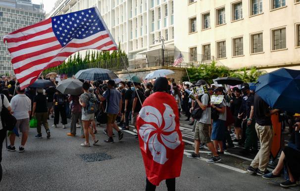 Manifestacion de peticion de ayuda a eeuu en Hong Kong. / EFE