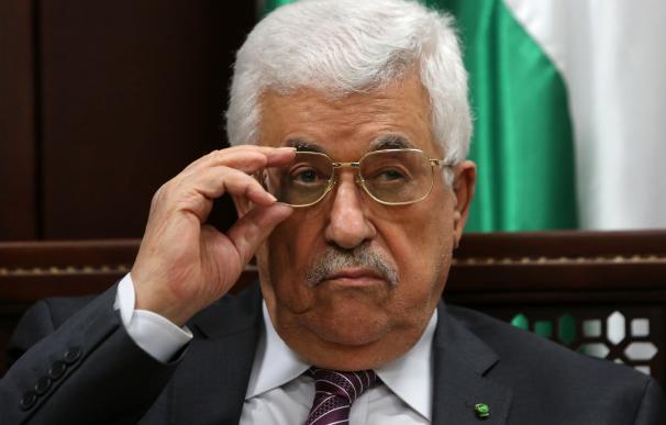 Palestinian leader Mahmud Abbas gestures during a