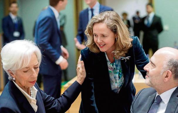 Foto Calviño, Moscovici y Lagarde / EFE-Olivier Hoslet