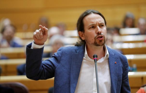 El vicepresidente segundo y ministro de Derechos Sociales, Pablo Iglesias, interviene durante la sesión de control al gobierno, en el Senado. /EFE/ Emilio Naranjo