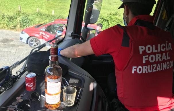 Camión con botella de alcohol